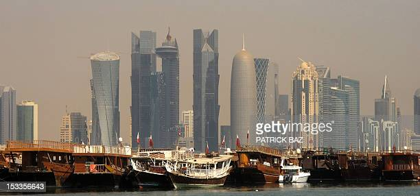 Boats are moored with the Qatari capital Doha skyline in the background on October 4 2012 Formerly a British protectorate Qatar has been ruled as a...