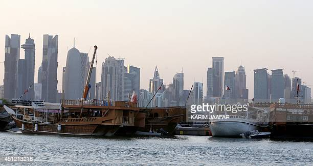Boats are moored with the Qatari capital Doha skyline in the background on June 25 2014 Qatar facing growing corruption allegations over the 2022...