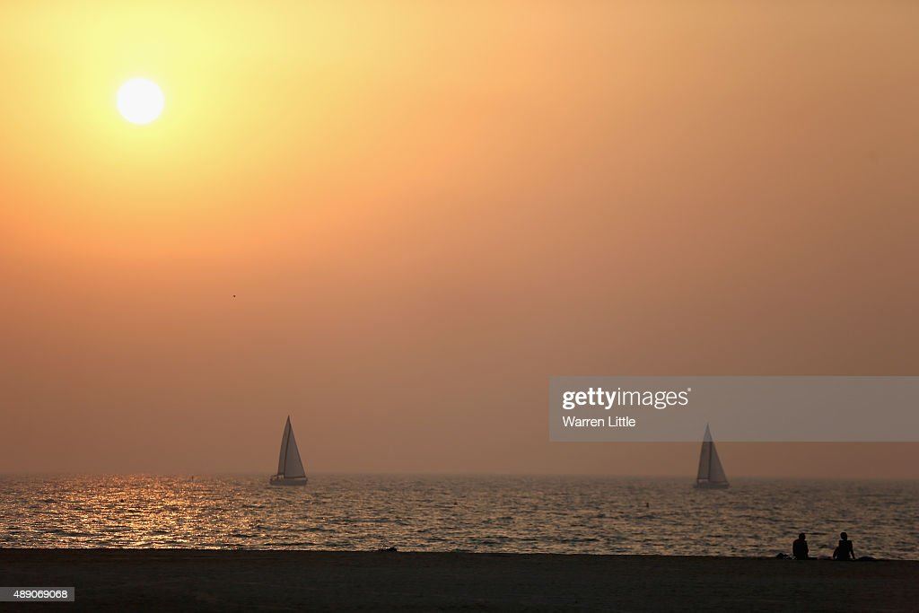 Boats are pictured off the recently refurbished Kite Beach on September 15, 2015 in Dubai, United Arab Emirates. The Beach is very popular with Dubai locals, with a variety of watersports and refreshments on offer.