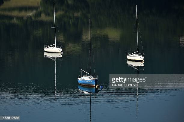 Boats are pictured on the lake of Bilancino near Mugello in the Province of Florence Tuscany on June 1 2015 AFP PHOTO / GABRIEL BOUYS