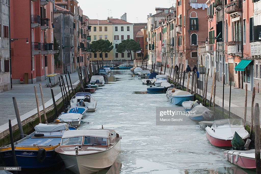 Boats are resting on a frozen canal in Venice on February 5, 2012 in Venice, Italy. Italy as most of Europe is under a spell of very cold weather, it is more than 20 years ago since the Venice Lagoon had last been frozen.
