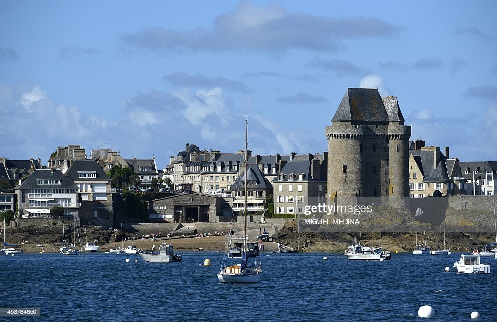 Boats are seen in front of the Solidor Tower in the Saint Servan neighborhood of SaintMalo Brittany western France on August 18 2014 AFP PHOTO /...