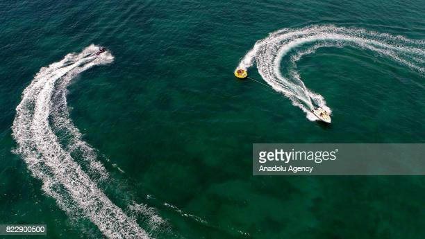 Boats are seen on Aegean Sea in Izmir Turkey on July 25 2017 In Summer's extreme hot days people try to cool themselves off with various sea...