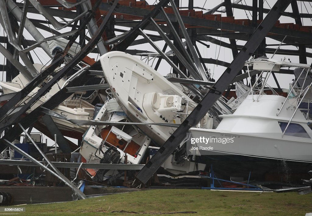 Boats are seen tossed around after Hurricane Harvey passed through on August 26, 2017 in Rockport, Texas. Harvey made landfall shortly after 11 p.m. Friday, just north of Port Aransas as a Category 4 storm and is being reported as the strongest hurricane to hit the United States since Wilma in 2005. Forecasts call for as much as 30 inches of rain to fall in the next few days.