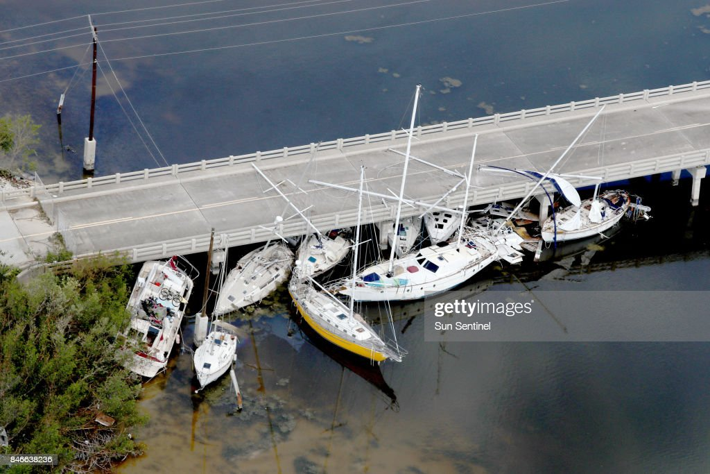 Boats are wedged under a bridge in Marathon in the Florida Keys after Hurricane Irma, on Wednesday, Sept. 13, 2017.