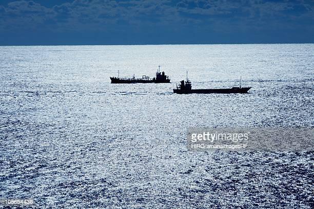 Boats at shiny sea