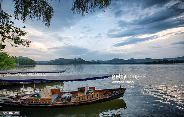 Boats at West Lake shore in Hangzhou, Zhejiang, China, Asia