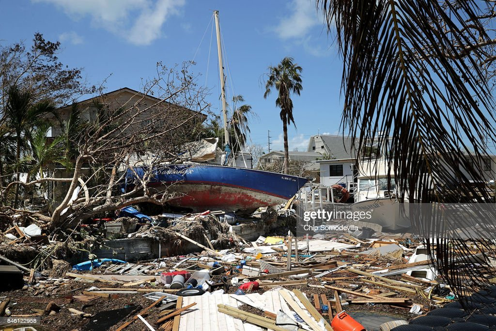 Boats, cars and other debris clog waterways in the Florida Keys two days after Hurricane Irma slammed into the state September 12, 2017 in Marathon, Florida. The Federal Emergency Managment Agency estimates that 25-percent of all homes in the Florida Keys were destroyed and 65-percent sustained major damage when they took a direct hit from Hurricane Irma.