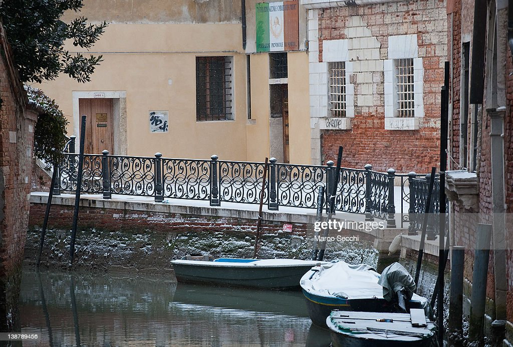 Boats covered with snow are moored along a quiet canal on February 12, 2012 in Venice, Italy. Italy, like most of Europe, is experiencing freezing temperatures, with the Venice Lagoon freeezing for the first time in over 20 years.
