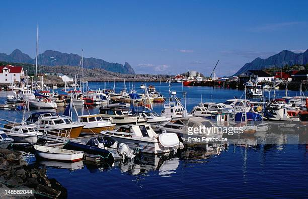 Boats crowd the scenic Svolvaer marina on Austvagoy in the Lofoten Island group. The area is famous for cod and  wars have been fought to own the rights to the rich fishing grounds.