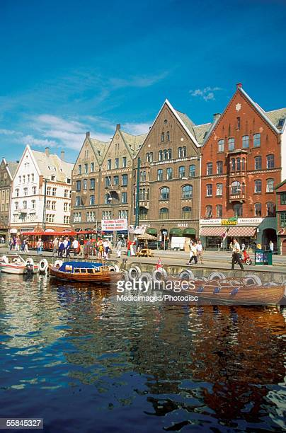 Boats docked at a river bank, Bergen, Norway