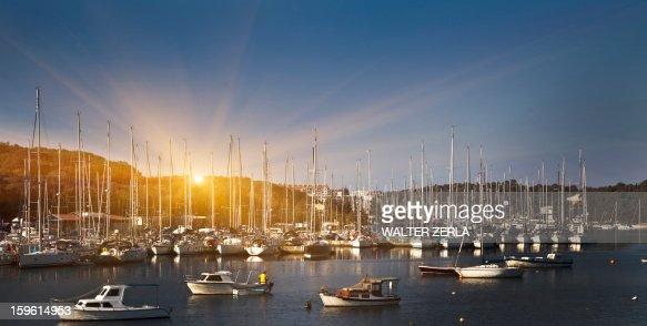 Boats docked in rural harbor : Stock Photo