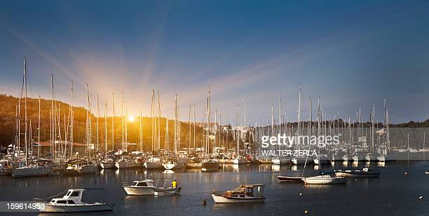 Boats docked in rural harbor