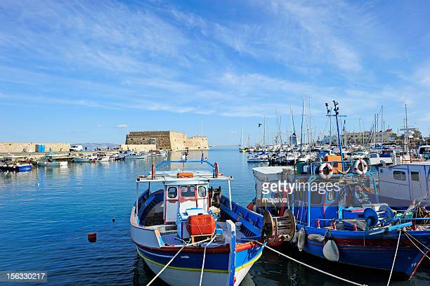 Boats docked in the blue waters of Iraklion