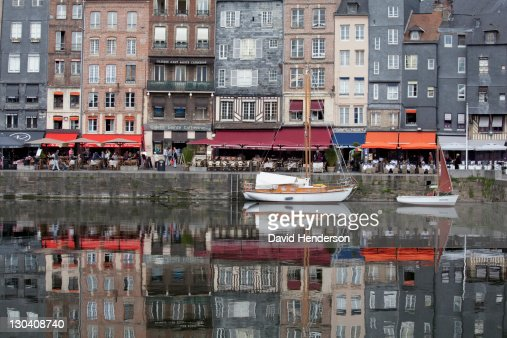 Boats docked in urban canal : Stock Photo