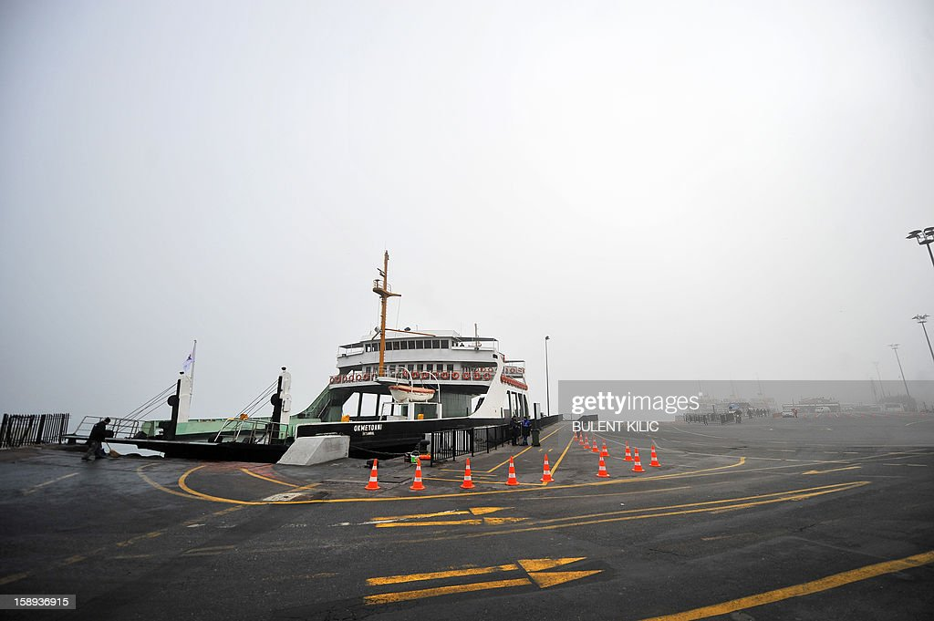 A boats docks at Eminonu landing early on January 4, 2013, in Istanbul. River traffic was brought to a halt this morning due to fog conditions.