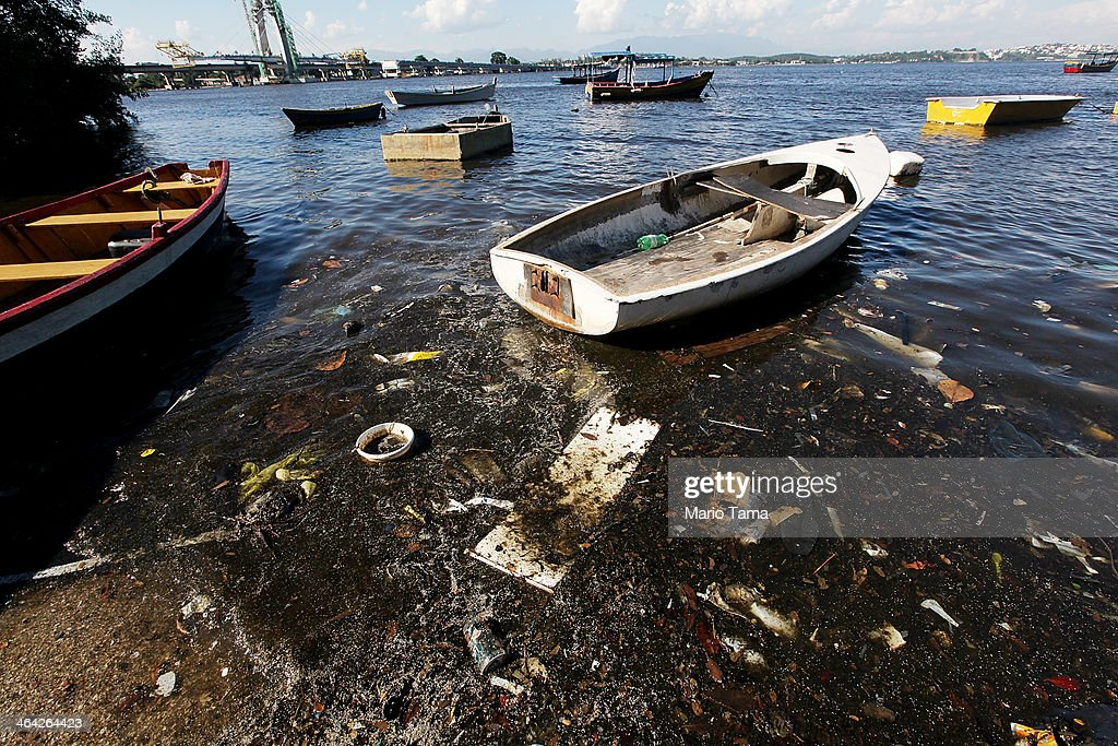 Boats float along the shoreline of the polluted waters of Guanabara Bay on January 21, 2014 in Rio de Janeiro, Brazil. The iconic bay will be the site of sailing events during the Rio 2016 Olympic Games. Although Rio's Olympic bid included the promise to clean up the filthy bay, industrial and human pollution still remain a major problem. According to the Deputy State Secretary of Environment just 34% of Rio's sewage is treated while the remainder flows untreated into the waters.