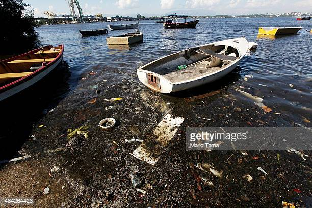 Boats float along the shoreline of the polluted waters of Guanabara Bay on January 21 2014 in Rio de Janeiro Brazil The iconic bay will be the site...