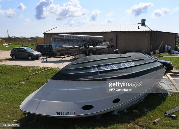 Boats for sale are displayed after Hurricane Harvey caused widespread destruction in Rockport Texas on September 1 2017 Houston was limping back to...