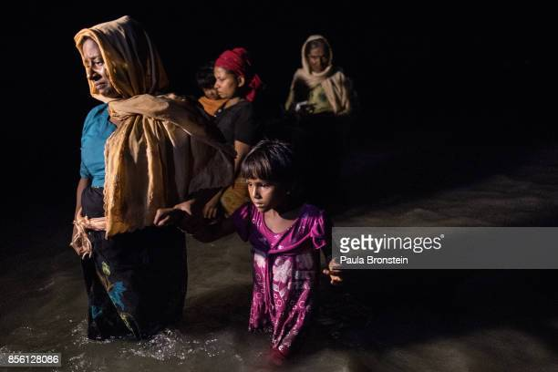 Boats full of people continue to arrive along the shores of the Naf River as Rohingya come in the safety of darkness September 30 2017 on Shah Porir...