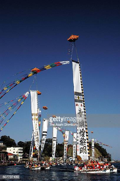 Boats holding flags float during the Ogi Tomobata Festival on May 3 2005 in Noto Ishikawa Japan