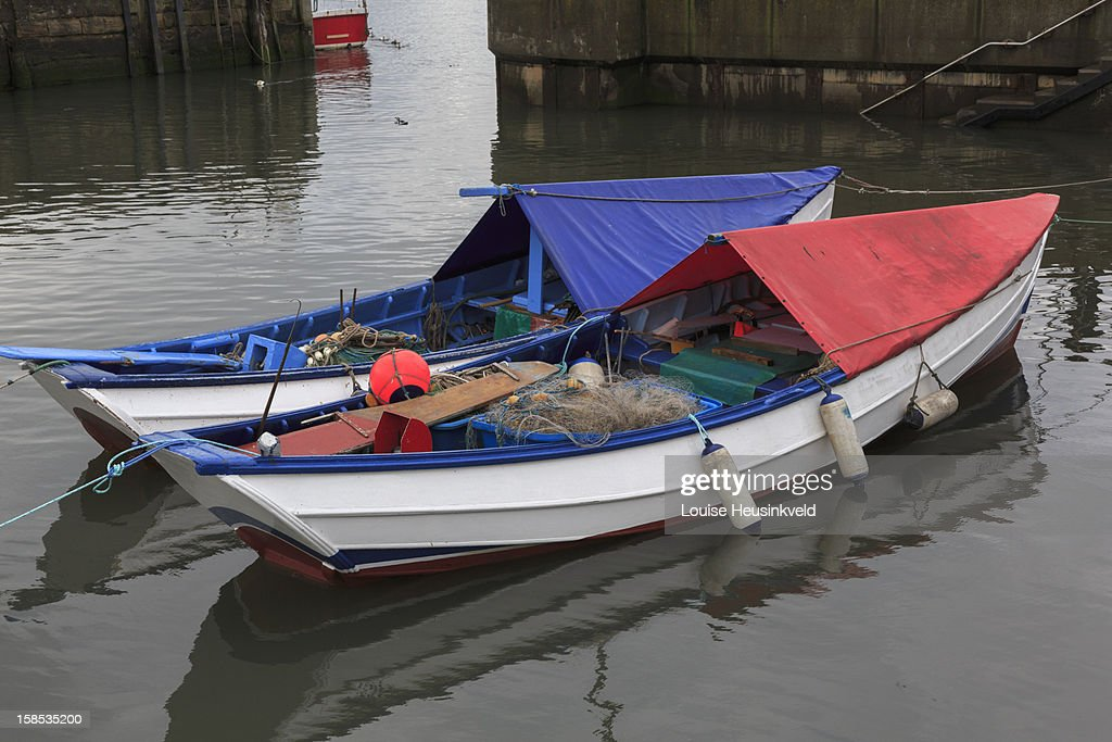 Boats in a harbour, Northumberland : Stock Photo