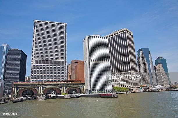 Boats in ferry slips below office towers