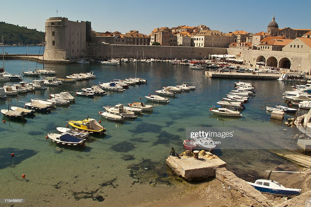 Boats in old harbour port of walled city of Dubrovnik on Dalmatian coast of the Adriatic Sea on May 13, 2011 in Dubrovnik, Croatia. The old town of Dubrovnik is a UNESCO World Heritage Site and surrounded by a 1,9 km long city wall and called the Pearl of the Adriatic.