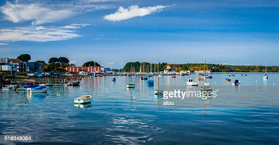 Boats in Poole Harbour, Dorset, looking out to Brownsea Island : Stock Photo