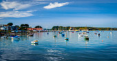 Leisure and fishing boats in Poole Harbour in Dorset, looking out to Brownsea Island from Sandbanks