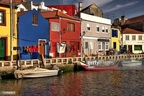 Boats in river with colorful houses, Aveiro.