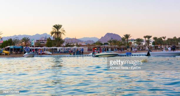 Boats In Swimming Pool Against Sky