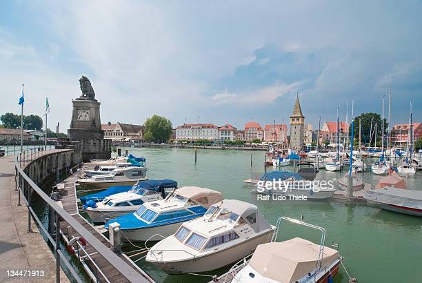 Boats in the harbor, port entrance and lion sculpture on the left, Lindau on Lake Constance, Bavaria, Germany, Europe