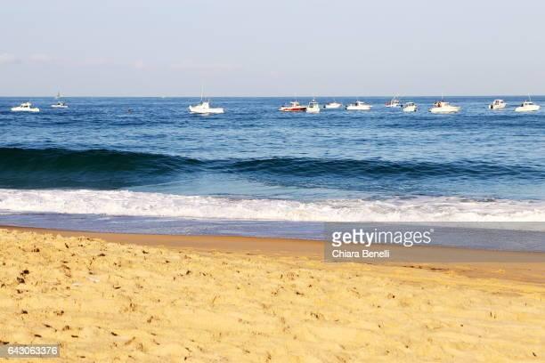 Boats in the ocean in front of hossegor
