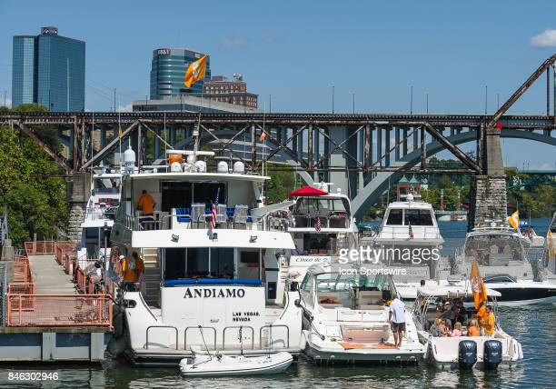 Boats in the Vol Navy on the Tennessee River outside Neyland Stadium with the Knoxville skyline in the background prior to a game between the Indiana...