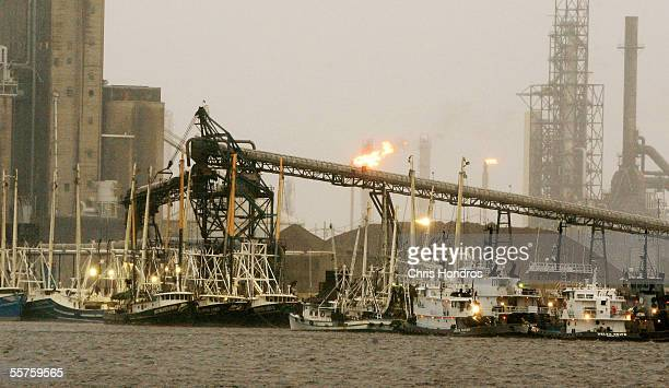 Boats line up near an oil refinery at the Port of Beaumont as Hurricane Rita approaches September 23 2005 in Beaumont Texas Hurricane Rita which has...