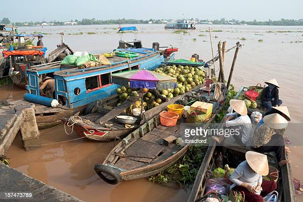 Boats Loaded With Passengers And Coconuts In Vinh Long, Vietnam