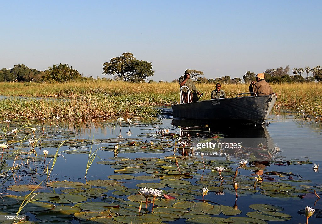 A boats makes its way through the Okavango Delta from Jao Luxury Safari Camp on June 18 2010 in Maun Botswana Camps run by Wilderness Safaris such as...