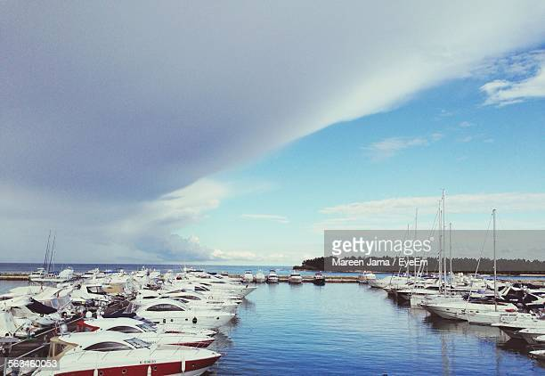 Boats Moored At Calm Sea Against The Sky