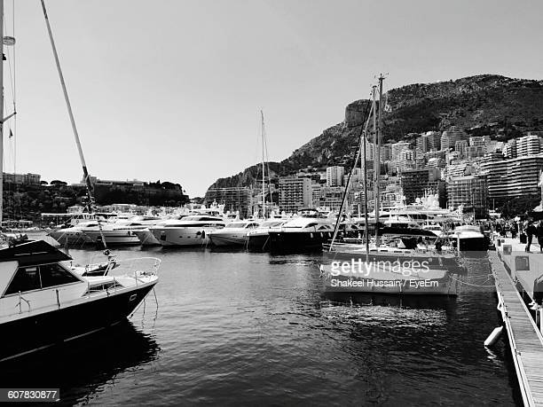 Boats Moored At Harbor By Buildings