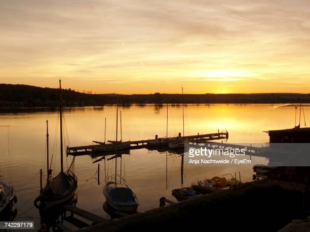 Boats Moored At Harbor During Sunset