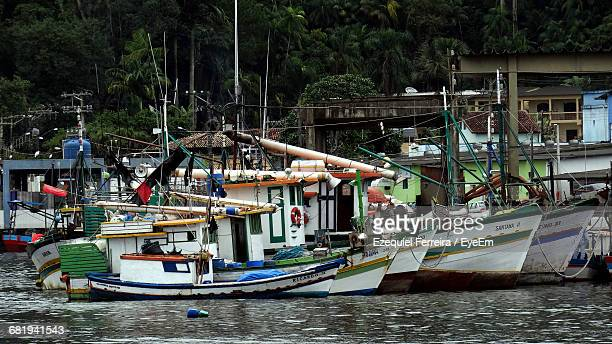 Boats Moored At Harbor In River
