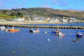 Boats moored in Lyme Regis Harbour, Dorset