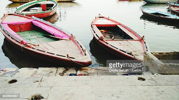 Boats Moored In River On Sunny Day