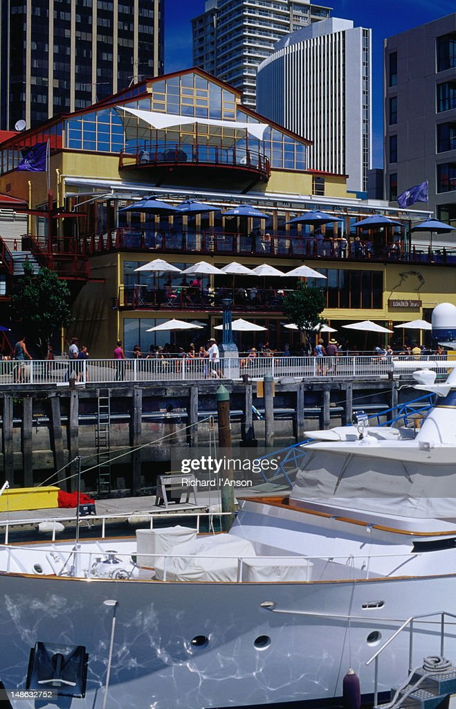 Boats moored in Viaduct Basin & waterside restaurants.