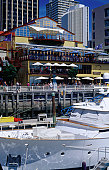 Boats moored in Viaduct Basin & waterside restaurants.