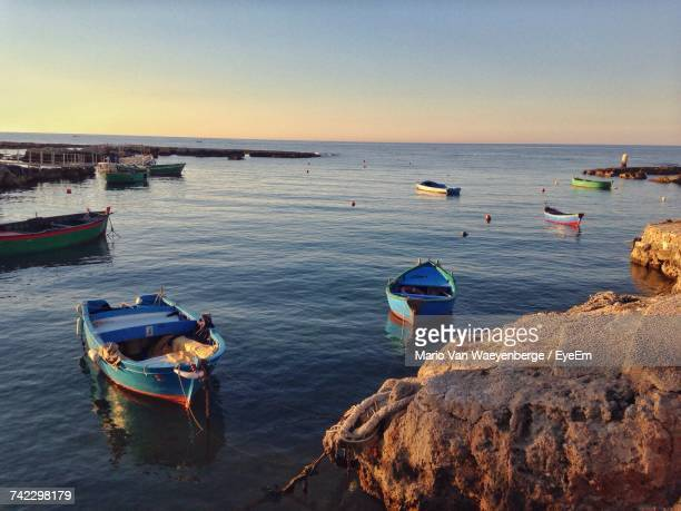 Boats Moored On Sea Against Clear Sky
