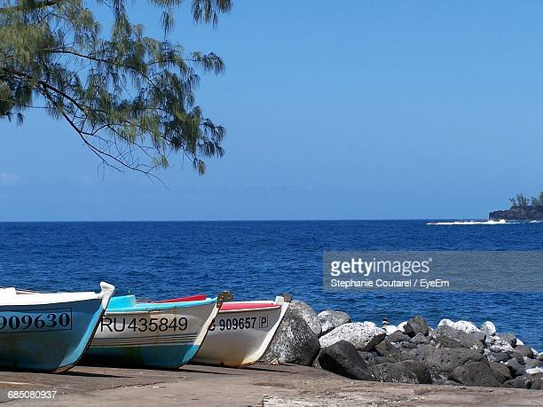 Boats Moored On Walkway Sea Against Clear Sky