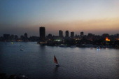 Boats move down the Nile at sunset on July 6 2013 in Cairo Egypt Over 17 people were killed in clashes around the country yesterday with dozens...