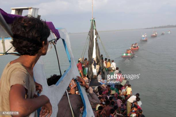 Boats of Acehnese fishermen tow a boat of Rohingya migrants in their boat off the coast near the city of Geulumpang in Indonesia's East Aceh district...